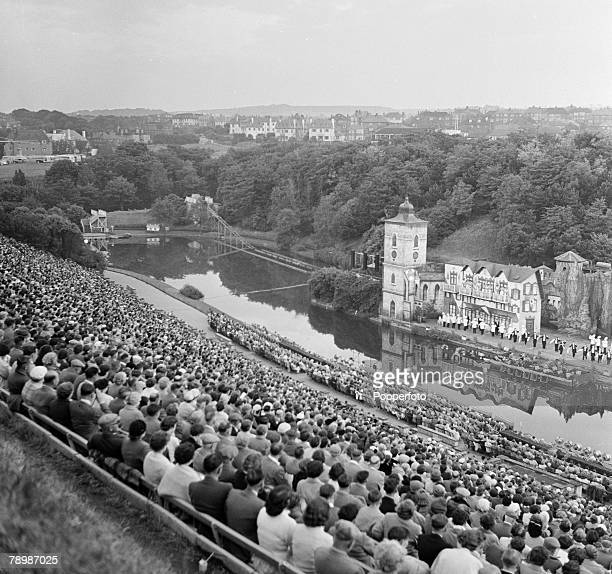 Travel Scarborough England A general overview of the Scarborough Open Air theatre with the hugh crowds of people looking down on the river