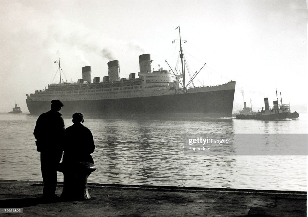 4th March 1953, The luxury British liner 'Queen Mary' at 'misty' Southampton after being held up in the Solent for 42 hours due to the fog