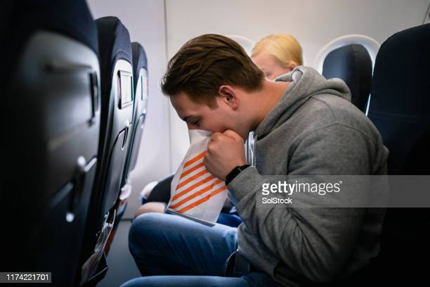 travel sickness on an airplane - sick bag stock photos and pictures