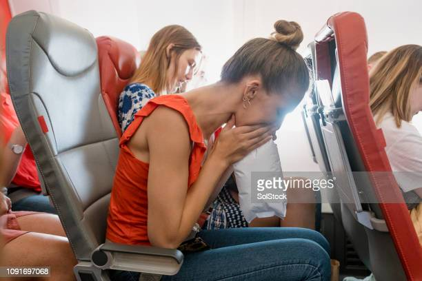 travel sickness - gagged woman stock pictures, royalty-free photos & images
