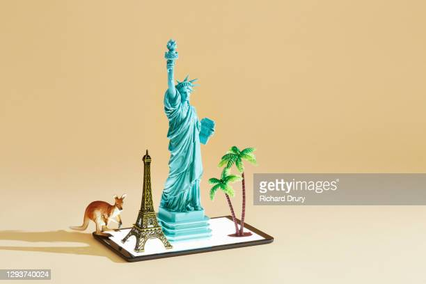 travel souvenirs emerging from a digital tablet - travel stock pictures, royalty-free photos & images