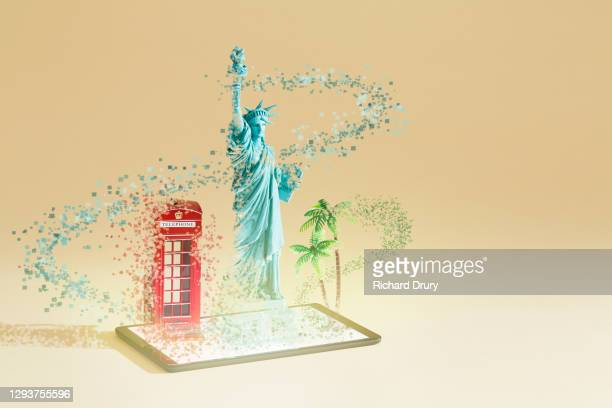 travel souvenirs emerging from a digital tablet - richard drury stock pictures, royalty-free photos & images