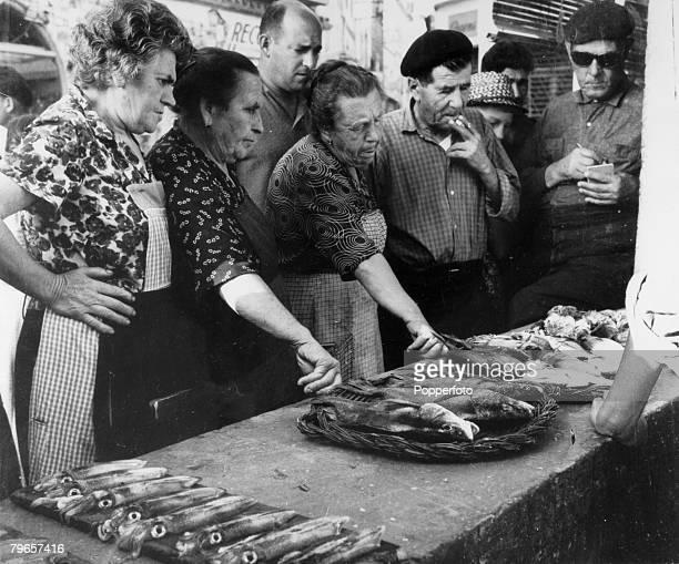 January 1963 Costa Brava Tossa de Mar Local women bidding for fish at the fish market
