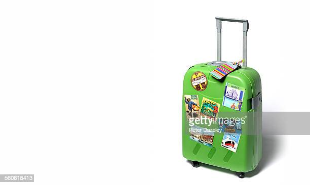 Travel suitcase with travel stickers