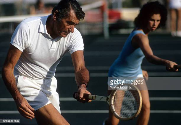 Tennis Lessons Portrait of tennis instructor Bill Sweeney giving women lessons during photo shoot at Acapulco Princess Hotel Acapulco Mexico CREDIT...