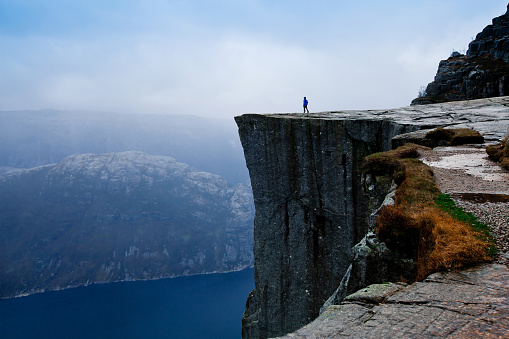 travel to Norway, person looking on the fjords 497256652