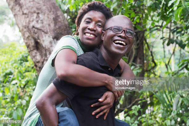 travel, tourism, summer holidays, happy couple is pleased to have fun campaign - côte d'ivoire stock pictures, royalty-free photos & images