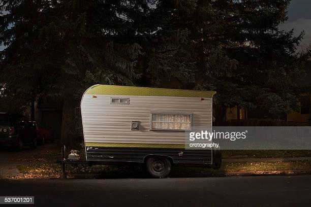 Travel trailer on street at night