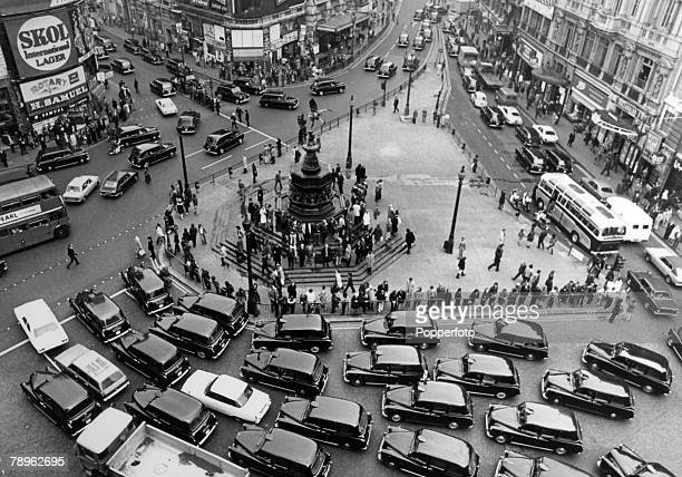 Travel Transport Cities England London pic 2nd November 1972 Taxis converge on London's Piccadilly Circus as the cabbies bring the area to a...