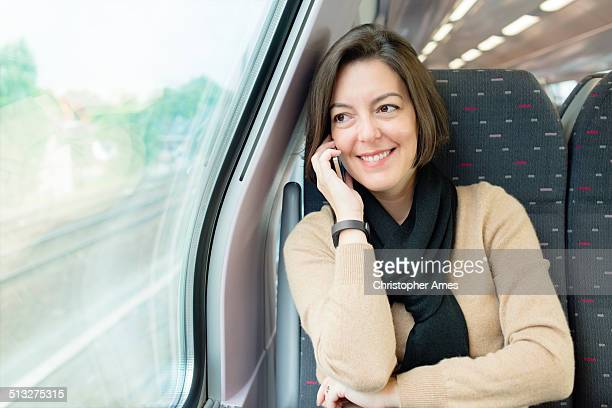 Travel - Traveling by Rail, Talking on Smartphone