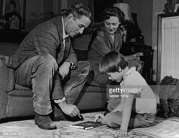 Travel writer Peter Fleming brother of Bond creator Ian Fleming at home with his wife English actress Celia Johnson and their daughter Lucy 1955...