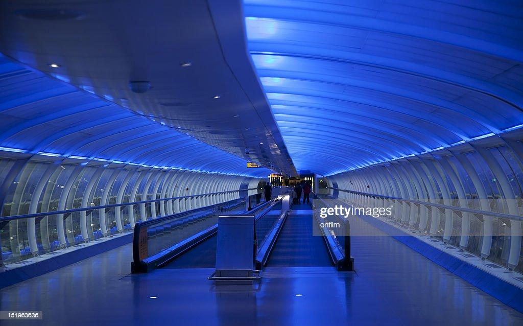 Travelator, moving walkway, blue lighting : Stock Photo