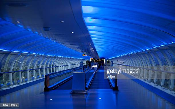 travelator, moving walkway, blue lighting - manchester international airport stock pictures, royalty-free photos & images