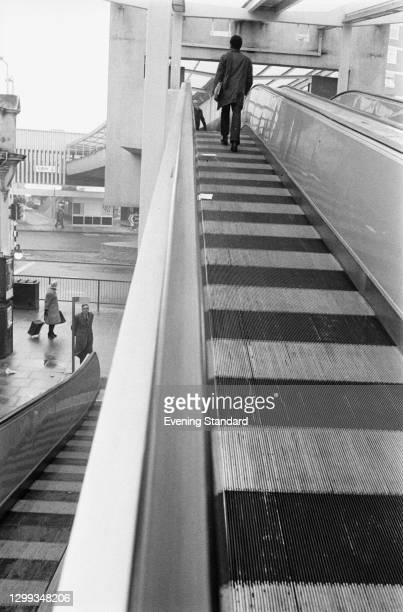 Travelator or people-mover in Shepherd's Bush Shopping Precinct in London, UK, 11th January 1972.