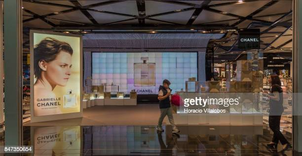 A traveler and salesperson are seen at Chanel stand in duty free area of Terminal 1 of Barcelona El Prat Airport on September 10 2017 in Barcelona...