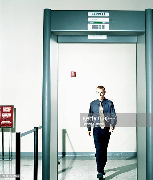 traveler approaching metal detector - security scanner stock pictures, royalty-free photos & images