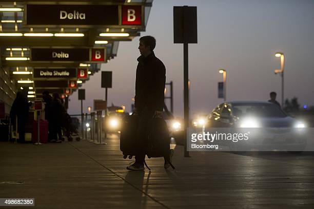 A traveler arrives at Ronald Reagan National airport in Washington DC US on Wednesday Nov 25 2015 Airlines for America the trade group for most large...