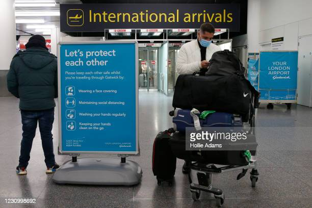 Traveler arrives at the North Terminal at Gatwick Airport on February 6, 2021 in London, England. The UK Government has confirmed that anyone...