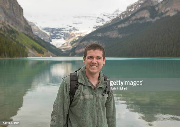 traveler at lake louise - chateau lake louise stock photos and pictures
