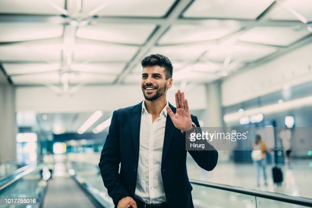 traveler at the airport - waving stock pictures, royalty-free photos & images