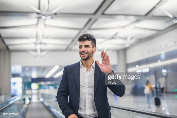 traveler at the airport - waving gesture stock photos and pictures