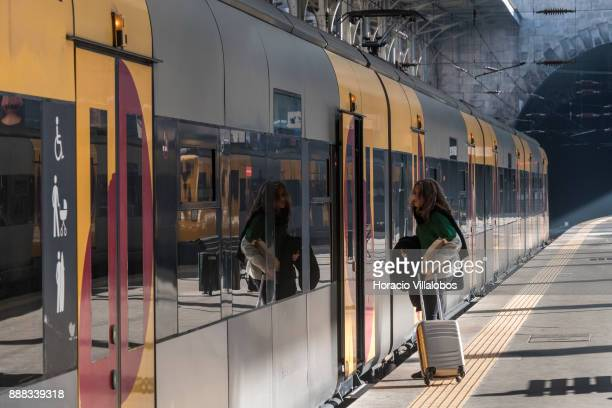A traveler boards a local train at Sao Bento train station during the visit to the premises by participants of Gastronomic FAM Tour on December 01...