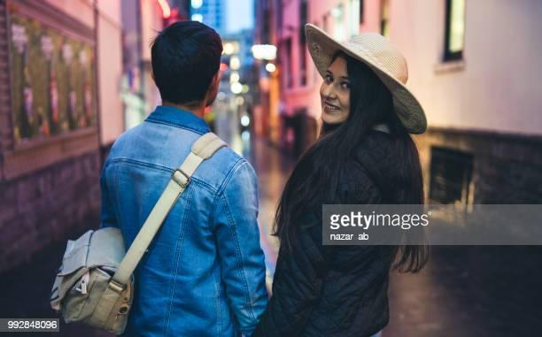 Traveler couple in city.