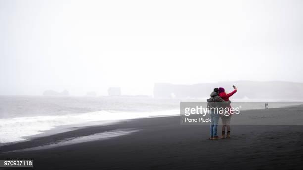 Traveler enjoy taking photo at Black sand beach, Iceland