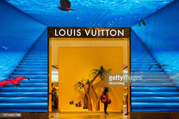A traveler enters a LVMH Moet Hennessy Louis Vuitton SE store at Terminal 3 of Changi Airport in Singapore on Thursday Dec 13 2018...