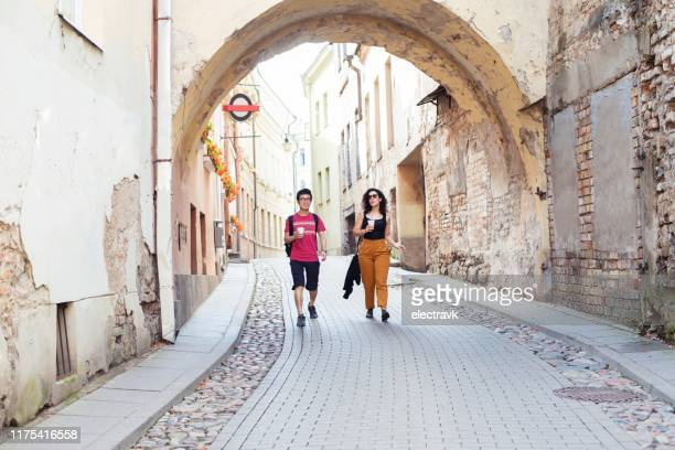 traveler exploring his destination with the help of a local guide - lithuania stock pictures, royalty-free photos & images