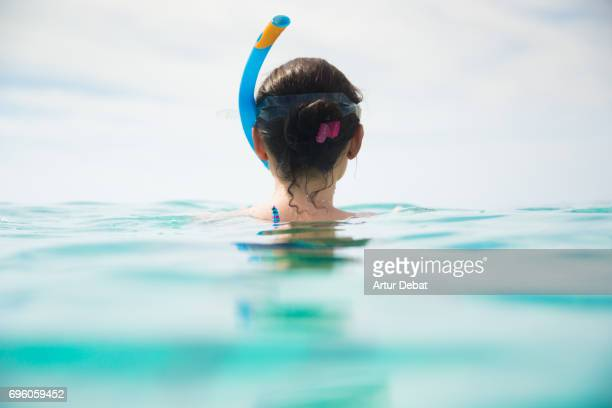 Traveler girl doing snorkel in the Gili islands a paradise in the Indonesia during travel vacations in the islands.