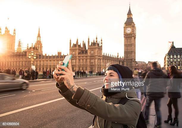 Traveler girl using smartphone