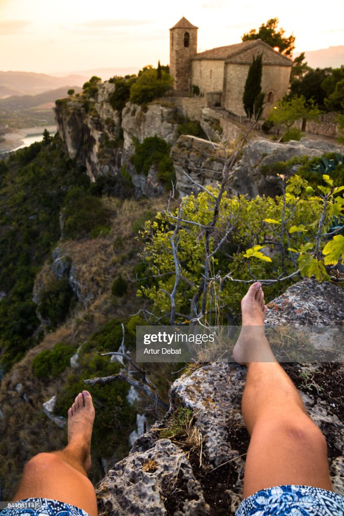 Traveler guy contemplating the view on sunset from the stunning Siurana town on top of cliff with amazing views during travel vacations in the Catalonia region. : Stock Photo