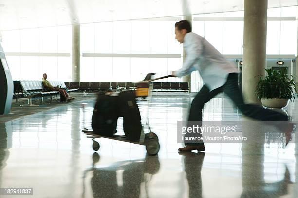 Traveler hurrying though airport