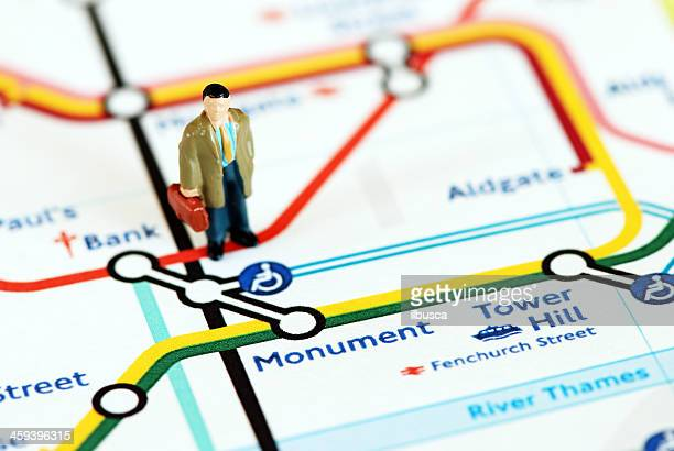 traveler in london - monument station london stock photos and pictures