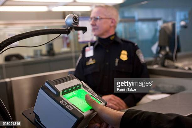 A traveler is fingerprinted using the new biometric scanner at the JFK International Airport in New York The new fingerprinting system currently...