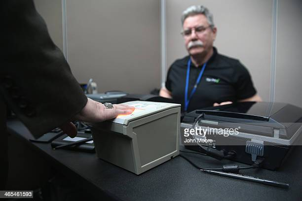 A traveler is fingerprinted while enrolling at a newlyopened TSA Precheck application center at LaGuardia Airport on January 27 2014 in New York City...