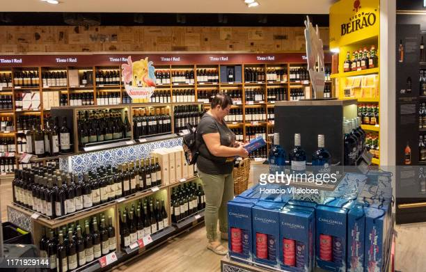 Traveler looks at products on display in the liquor section of the duty-free area in Humberto Delgado International Airport Terminal 1 on September...