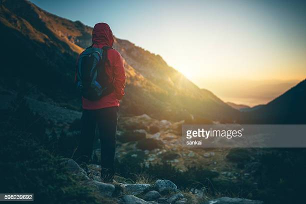 Traveler meets the sunrise in the mountains