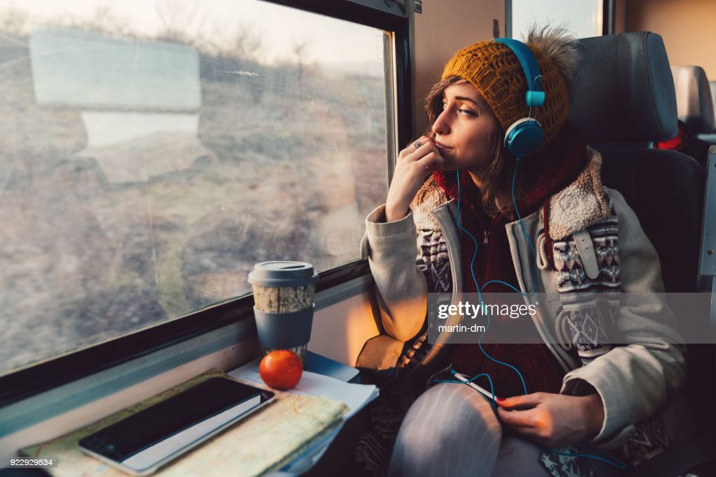 Traveler on a journey with train : Stock Photo