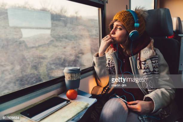 traveler on a journey with train - listening stock pictures, royalty-free photos & images