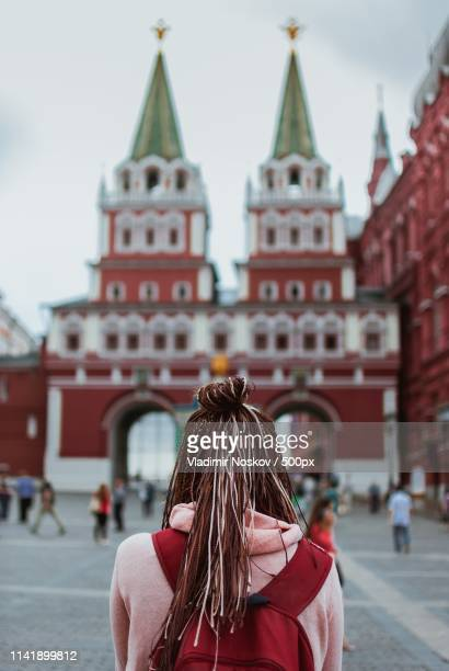 traveler on the red square - red square stock pictures, royalty-free photos & images