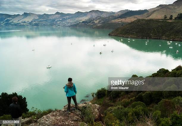 Traveler overlooking Lyttelton Harbour New Zealan