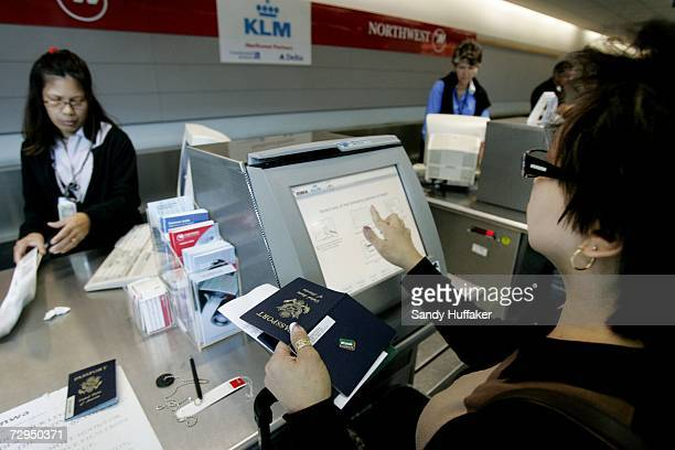 A traveler prepares to swipe her passport while checking in at San Diego International Airport January 8 2006 in San Diego California Beginning on...