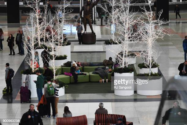 Traveler rest in the main terminal that is decorated for the holidays at Denver International Airport on January 3 2018 in Denver Colorado