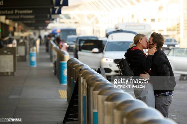 Traveler says goodbye on the departures level at Los Angeles International Airport ahead of the Thanksgiving holiday in Los Angeles, California,...