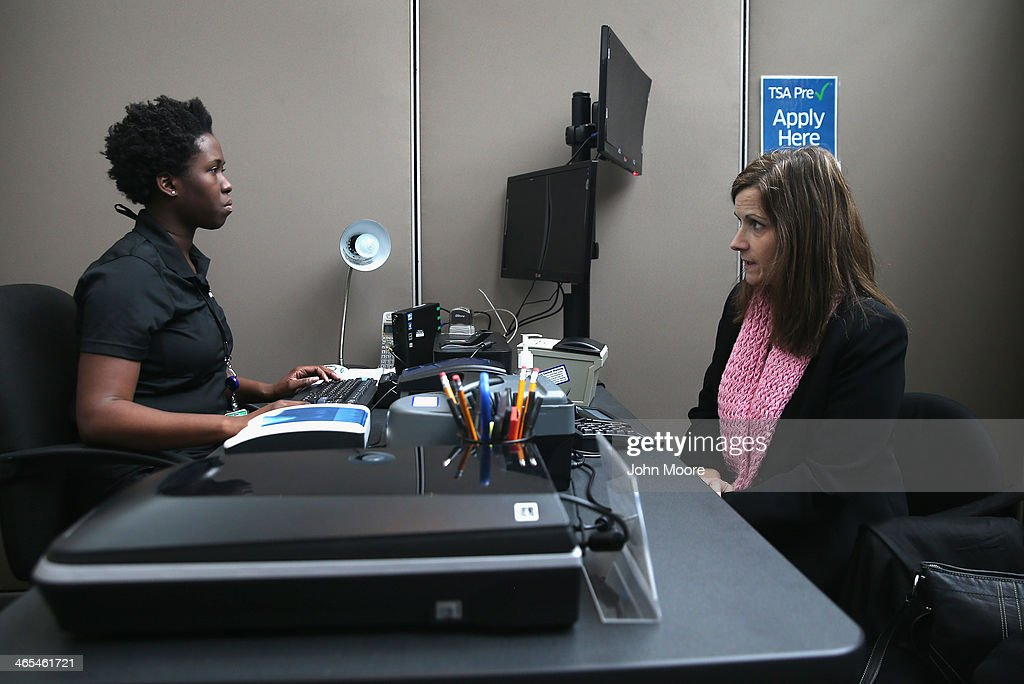 A traveler (R), sits for an interview while enrolling at a newly-opened TSA Pre-check application center at Terminal C of the LaGuardia Airport on January 27, 2014 in New York City. Once approved for the program, travelers can use special expidited Precheck security lanes. They can also leave on their shoes, light outerwear and belt, as well as keep their laptop and small containers of liquids inside carry-on luggage during security screening. The TSA plans to open more than 300 application centers across the country.