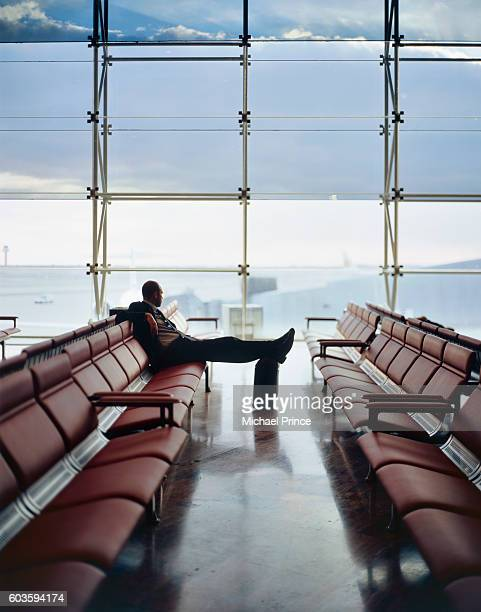 Traveler Sitting in Airport Terminal
