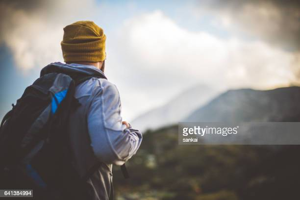traveler solitude in mountains - will power stock photos and pictures