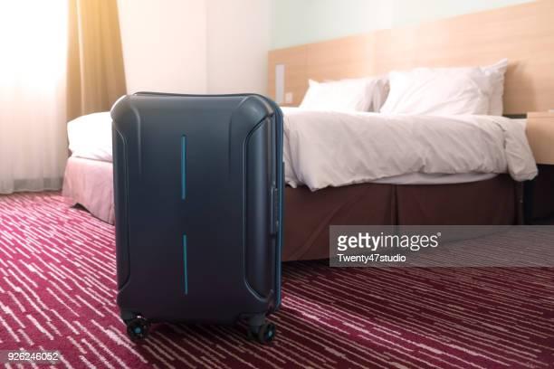 Traveler suitcase in hotel room, Travel concept